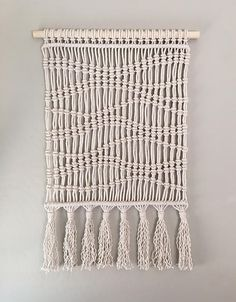 This macrame wall hanging was inspired by a recent hiking trip to Joshua Tree. The wave pattern reminds me of the winding paths found on hiking trails! Being very modern and organic, it looks great in any space! Wall hanging is on a light blonde wood dowel measuring 18 in. Macrame