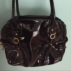 GORGEOUS leather and suede Juicy Couture handbag! This bag is absolutely beautiful! It's adorable on the inside. It is in excellent condition! Barely used! It is made from patent leather and suede trim! Perfect for any time of the year! Juicy Couture Bags Shoulder Bags
