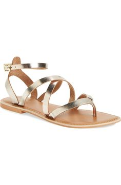 New warm-weather staple! These flat leather thong sandals from Topshop are styled with crisscrossing straps and finished with metallic gleam.