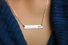 Stylish necklace personalized with your loved ones badge number. Sterling silver or 14K gold.