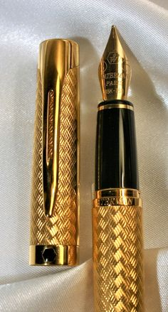 Waterman L'Etalon Fountain pen 18K gold Medium nib, Gold plated finish over a durable all-brass construction, highlighted by 23.3K gold-plated trim. The curved, articulated clip has a shape that is substantial yet elegant