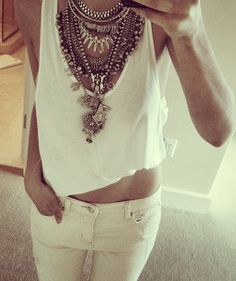Layered necklaces atop an all white ensemble