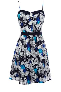 This pretty sundress has an all over floral pattern with contrast binding to the waist and bust. Finished with thin straps, this is perfect for a summers day.