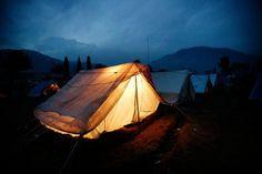 somber setting, lovely lit tent