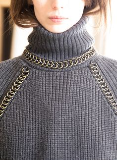Matte and shine: a chunky knit turtleneck with chain-link detail #toryburchfall2014 #nyfw