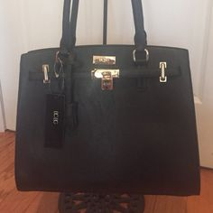 BCBG black bag This beauty is just perfect. 11 inches high and 14 wide at base, gold trim, handles are 21 inches total length, so approx 10 inches from top of bag to where handle curves over your elbow or shoulder. Back is plain, inside is a middle zipper section, and on the inside back there is another zipper section and the inside front has pockets in the lining. Open space and well designed. BCBG Bags Shoulder Bags