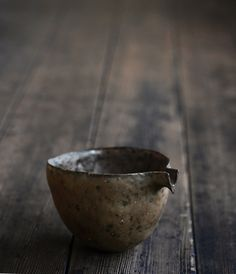 Tea pitcher at analogue life. Wabi Sabi may be seen in pottery where the pieces appear rustic and simple-looking, such as Japanese Hagi pottery with shapes that are not quite symmetrical, and colors or textures that appear to emphasize an unrefined or simple style. Wiki