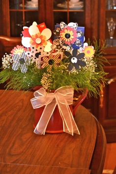 Teacher appreciation gift card bouquet with reusable paper flowers and pitcher