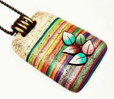 Colorful Striped polymer clay pendant with leaves.  Pendant by EL RINCON DE AMATISTA | Polymer Clay Planet