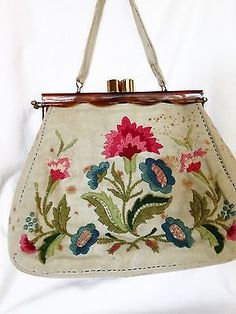 Vintage-1950s-Lucite-Frame-Handbag-with-Embroidered-Cover-in-Good-Condition
