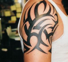 Tribal shoulder tattoo...Hm...I wish my boyfriend would get this :(