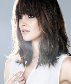 this is a great shape for the length of her hair. I also like how the heaviness of the bangs offsets the texture on the ends