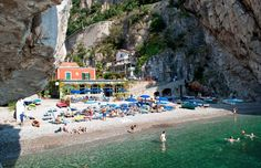 beach in Praiano - access by staircses built into the rocks : the Amalfi Coast – On the Luce travel blog