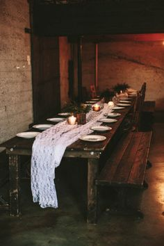 Long farm table, lace table runner, and candles   Image by Lauren Scotti