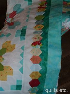 Lucy Boston patchwork of the Crosses on Pinterest | 30 Pins. Nice border treatment.