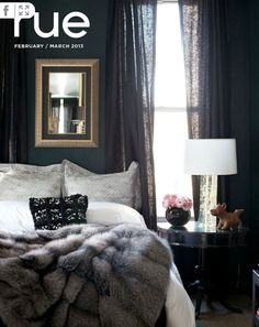 Love the dark paint with the white bedding!