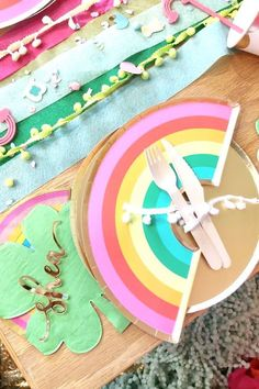 Take a look at this pretty Spring-themed rainbow birthday party! The table settings are lovely! See more party ideas and share yours at CatchMyParty.com #catchmyparty #partyideas #rainbow #rainbowparty #spring #springparty