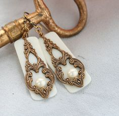 Upcycled Ivory Piano Key Jewelry, Ivory Earrings, Victorian Style Earrings, Pearls, Wedding, Handmade. $29.99, via Etsy.