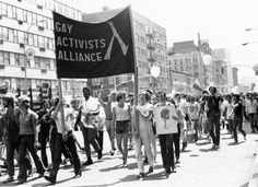 Gay Activists Alliance (Vito Russo in striped trousers) marching in the first Christopher Street Liberation Day parade, 1970. Photograph by Kay Tobin Lahusen.   The New York Public Library, Manuscripts and Archives Division, Barbara Gittings and Kay Tobin Lahusen Gay History Papers and Photographs.