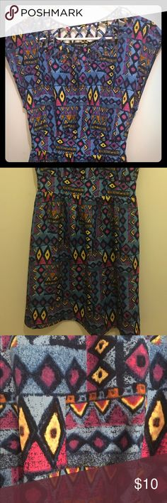 Forever 21 Aztec dress w/ banded waist & cut outs Fun blue, purple, and yellow Aztec print dress. Banded waistband. Cut out neckline. Frayed thread in a few spots (barely noticeable). Forever 21 Dresses Midi