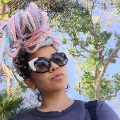 black girl in colorful hair | pastel hair | pink hair | box braids inspiration