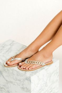 If you pack just one pair of sandals for your next vacation that will be Thalassa flip flops. Handmade in Greece of top quality silver leather, these thongs rest on a comfortable anti-slip rubber sole, feature our signature woven strap in gold. Second to going barefoot, these elegant flat sandals are the lightest option for summer. Specially designed for day-to-night wear, slip them on with a bikini poolside, switching to a boho dress for dinners on the beach. Boho Sandals, Ankle Wrap Sandals, Silver Sandals, Metallic Sandals, Greek Sandals, Women Sandals, Flat Sandals, Flats, Leather Clutch Bags