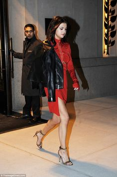 Lady in red: Selena Gomez showed off her sculpted physique in an asymmetrical dress on Tuesday in New York City