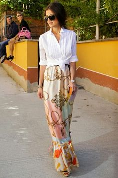 Tuxedo blouse tied at the waist and a printed silk maxi skirt evoke a cool seventies vibe (Elle Spain)