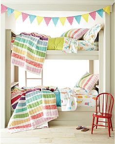 Love the rainbow streamers quilts and bright colors! Perfect for the kids' corner in our dream family bedroom!