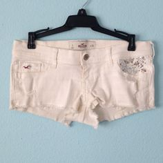 White Hollister Jean shorts Used to be my favorite white shorts. Stretchy sturdy material. Jewels in the front. Hollister Shorts Jean Shorts