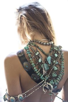Chunky turquoise & silver layered necklaces for a boho chic hippie look.