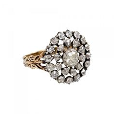 Georgian Old Mine Diamond Cluster Ring, in Silver and 15K Gold offered by Kentshire on InCollect