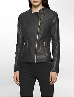 a trendy moto jacket in smooth faux leather with rib knit trim details featuring an asymmetrical zip closure and gold hardware detailing.