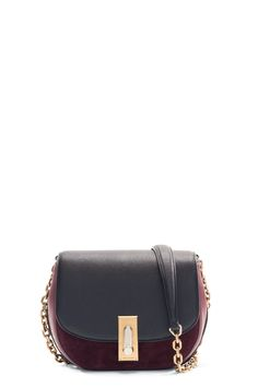 The Marc Jacobs West End Jane Suede makes a statement with contrasting leather…