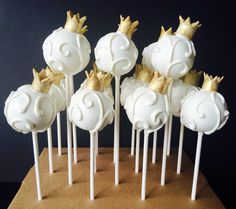 All white and white swirled cake pops with gold crown
