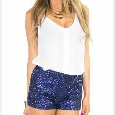 "Sassy Blue sequin shorts NWOT Brand new without tags  Sassy and vibrant blue mini sequin shorts. Pair these fabulous shorts with a white top, blazer and heels or a playful top and sandals.   Inside is lining with blue material, elastic waist band allows for some stretch. She'll 100%nylon, lining 95%polyester 5%spandex, contrast(band) 94% rayon 6%spandex.  Small length approx 10.5"" Medium length approx 11"" Large length approx 11"" Shorts"