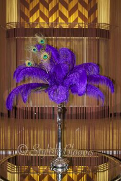 purple feather arrangement- different colors a could be a cool addition to center pieces
