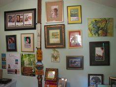 The framed covers to my novels hang on one wall