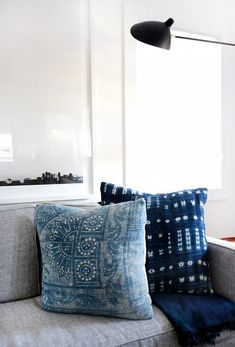 Mix of pillow styles on a neutral sofa