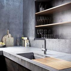 Polished cement countertop and wood cabinets doors