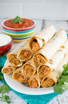 These Cheesy Taco Taquitos are loaded with meat, cheese, and tomatoes. They are…