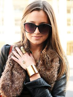 Danielle protects her eyes with extra-large sunnies in a matching hue to the rest of her outfit.