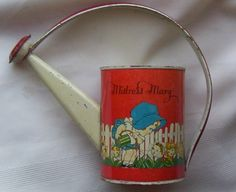 This 1930's or 40's child's T. Cohn tin litho watering can has colorful ...  home.earthlink.net