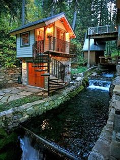 This quaint, two-bedroom cottage has a creekside hot tub, a woodburning fireplace, and a detached sleeping area.