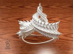 Check out Zenith crown : A 3D fractal design  by unellenu on Shapeways and discover more 3D printed products in Mathematical Art.