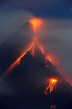 Lava spills from Mayon Volcano in Albay Province, Philippines. It was finally declared a no-fly zone due to the great number of tourist wanting to get birds eye views of the volcano events.