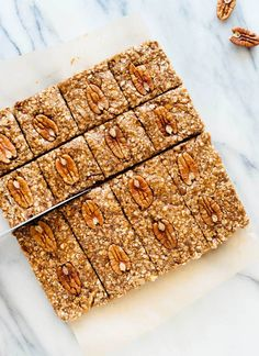These no-bake pecan granola bars taste one million time better than store-bought granola bars! They're gluten free and vegan, too. Get the recipe at cookieandkate.com