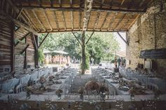 A Rustic French Wedding With Very Pretty Details. Barn with 80 people. Wedding breakfast. Pink centre pieces.