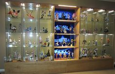 raised detolfs and bookcase with backlighting Action Figure Display Case, Nerd Room, Toy Display, Display Ideas, Matou, Man Cave Home Bar, Displaying Collections, Glass Shelves, Game Room