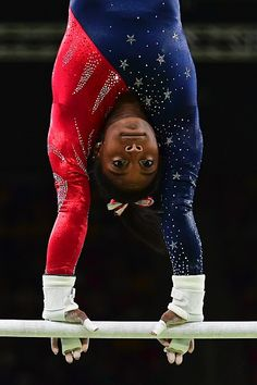 US gymnast Simone Biles competes in the qualifying for the women's Uneven Bars…